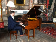 A member of the London Piano Meetup Group performing at LASSCO Brunswick House
